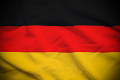 Wavy and rippled national flag of Germany background.